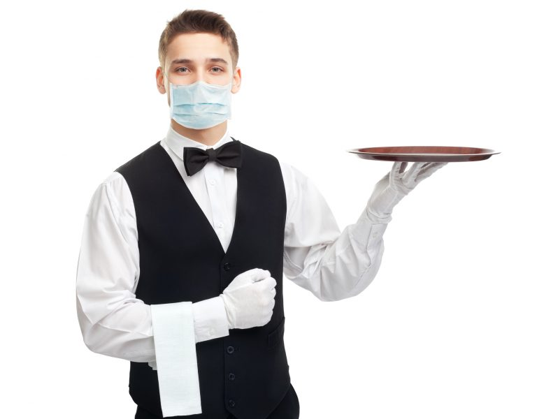 Portrait of young happy smiling waiter with empty tray isolated on white background